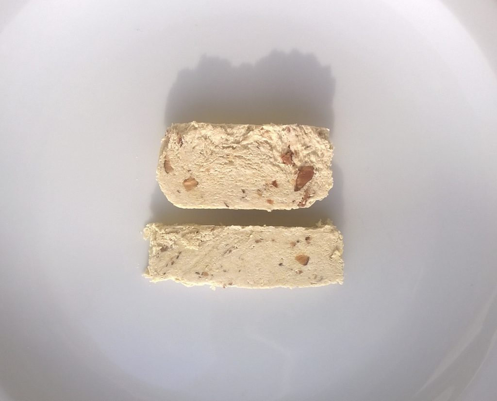 Two slices of Handmade Halva with Almonds by Kandylas