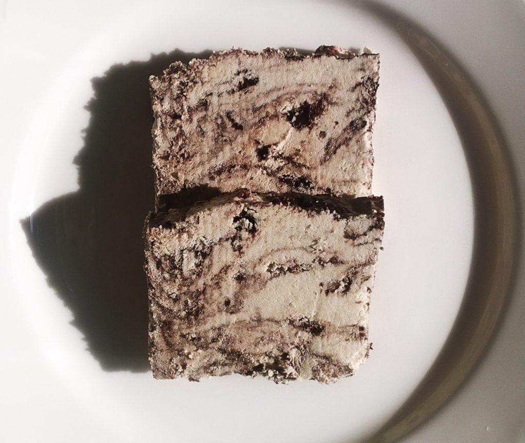 Two slices of Al-Rabih halva with chocolate