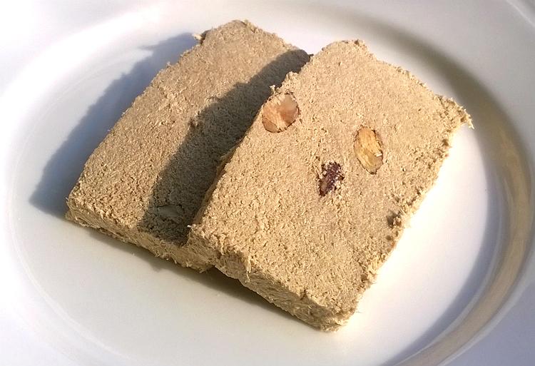 Two slices of Halvas Almond with Whole Grained Tahini & Brown Sugar by Halvas Drapetsonas