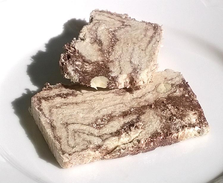 Two slices of Halva with Chocolate & Almonds by Halvas Drapetsonas