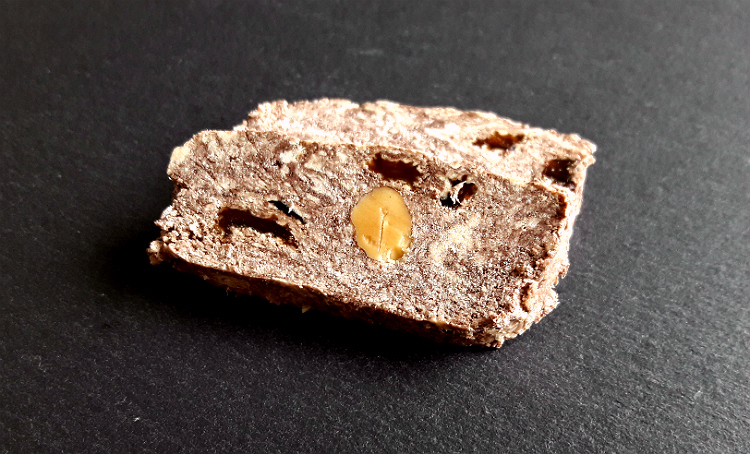 Two slices of Olympos Royal Halva with Cocoa, Almonds & Raisins by Papayianni Bros